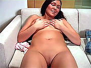 A very busty chick pleasuring her wet pussy