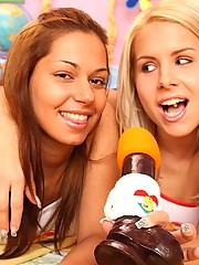 Two hot teenagers singing karaoke with dildo