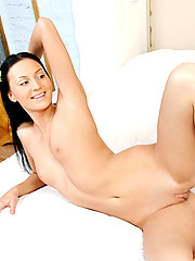 Naughty Alexcia looks great on her bed as she teases with her assets and pleasures her pussy