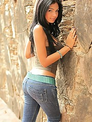 Karla flaunts her beautiful naked body by a rock wall