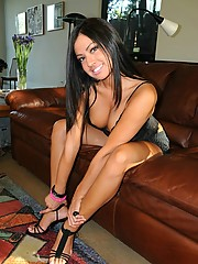 Cierra takes her black lace outfit and plays naked in her leather couch