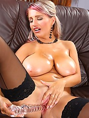 Busty blonde oiled up and toying