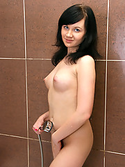See how this hot babe wet her tender pussy with the shower head as she brags her assets in the bathroom