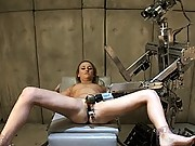Blonde in straight jacket, bound to Sybian is made to cum and a giant robot vibes her clit with a speculum holding her gaping, juicing pussy open.
