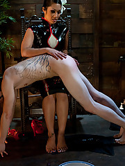 Exotic dominatrix makes slave into foot worshipping whore then covers dick with huge humiliating cock sheath so he can