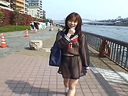 Mikan Asian teen smiles and flashes titties while touring city