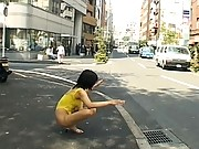 Unknown Model poses in her gym outfit on the sidewalk by her home