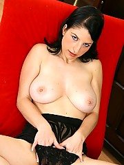Cute busty chick oiling up her massive tits