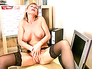 Classy office lady masturbates on her desk wearing high heels