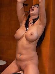 Isis Love tied up to the Sybian, nipples sucked tight, her cum squirting all over machine making puddle on the floor, she begs for the vibing to stop.
