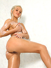 Blonde Nubile Yelena shows off her tits and gets soaking wet in the bathtub