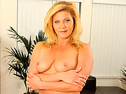 Tan blonde cougar masturbates with a glass toy after work
