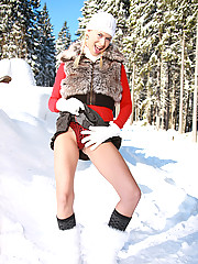 Teenager plays with her wet pussy in the snow