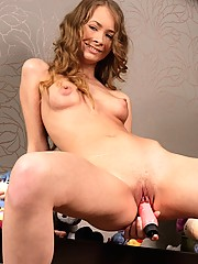 Chick stuffing a big pink dildo in her anus