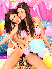 Two hot lesbians wearing very sexy lingerie
