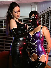 Kinky mistress corrects her submissive slave in tight latex