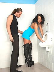 A very freaky babe loves drinking piss in a public restroom