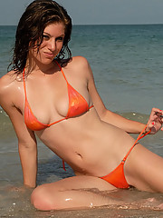 Hannah in a metalic orange bikini