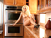 """""""Blonde bombshell Gina Lynn poses for pics in a sexy clothes before stripping down"""""""