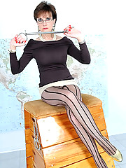 Mature dominatrix in pantyhose