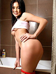 See Nubiles Sanya dripping wet pussy and tight wet body in the shower room