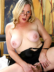 Mature sexy mom Jordan pops out her massive tits after a hectic day in the office