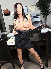 Busty brunette gets horny at work