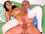 An old dude screwing a stockings wearing babe