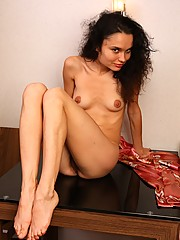 See slender Sarah slide out of her soft robe and model her perfect body and thick hairy bush on her lounge room table. What are you waiting for?
