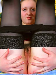 Evgenia T feels sexy on the couch in her black knickers so she wants to have a peak under her little skirt at her girl-cum filled hairy pussy.