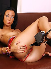 Aniie loves the feel of cold leather on her smoking hot body. Tonight she is especially kinky and needs to rub her meaty pussy hair until climax.