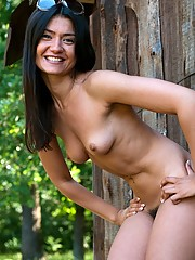 Julie loves being naked outdoors, and the thrill of possibly being caught excites her. Take a walk on the wild side as she shows her hairy pussy in the sunshine.