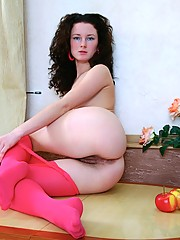 Kinky Kriss feels sexy in her bright pink stockings. Want to see what she is hiding underneath them?