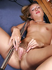 Julia begins vacuuming but thinking of that long metal shaft in her hand gets her too wet. So she seductively lifts her skirt and spreads apart her blonde haired pussy instead.