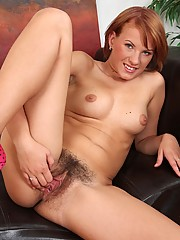 Cute Ansie is playing with her beautifully hairy pussy in her living room...she never gets bored!
