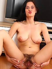 Beautiful, natural, and hairy...and she wants to play in your living room! She loves to get naked and kinky.