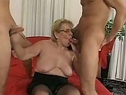 Grandma gobbling on a couple of guys