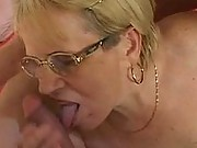 Granny gobbles and wanks two guys