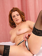 Brunette Anilos Maiky stuffs her tight milf pussy with a glass toy on top of the table