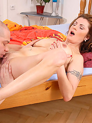 Busty mature Maiky sucks the hard cock of a hot stud before she gets power drilled on the bed
