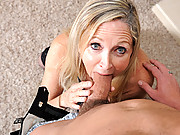 Wide eyed granny nearly chokes on a hard cock