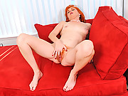 Classy red head fingers her hairy pussy until she cums