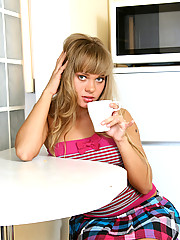 While having her coffee Halina feels horny so she gets naked and gives her pussy a finger fuck