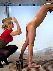 Blonde Dominatrix trains bitch slaveboy with large butt plugs and does a reversed pile driver on his ass!