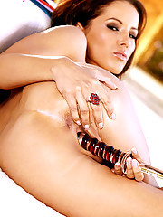 Angel Dark stuffs her tight pussy with a dildo while outside