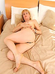 Horny milf stuffs a black dildo deep in her mature pleasure hole