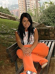 Gigi takes some fun candid photos at the park in her orange outfit