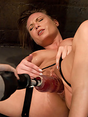 Harmony Rose bound with an apple shoved in her mouth as a gag is power tool fucked by two dongs at same time and a HUGE red beast cock until she cums.