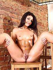 Teen Dashia takes off her clothes and pours oil on her luscious body