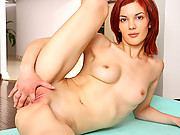 Ivory skinned red head masturbates after her workout